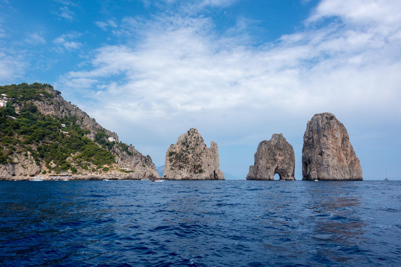 View of the Faraglioni from a private boat off the coast of Capri.