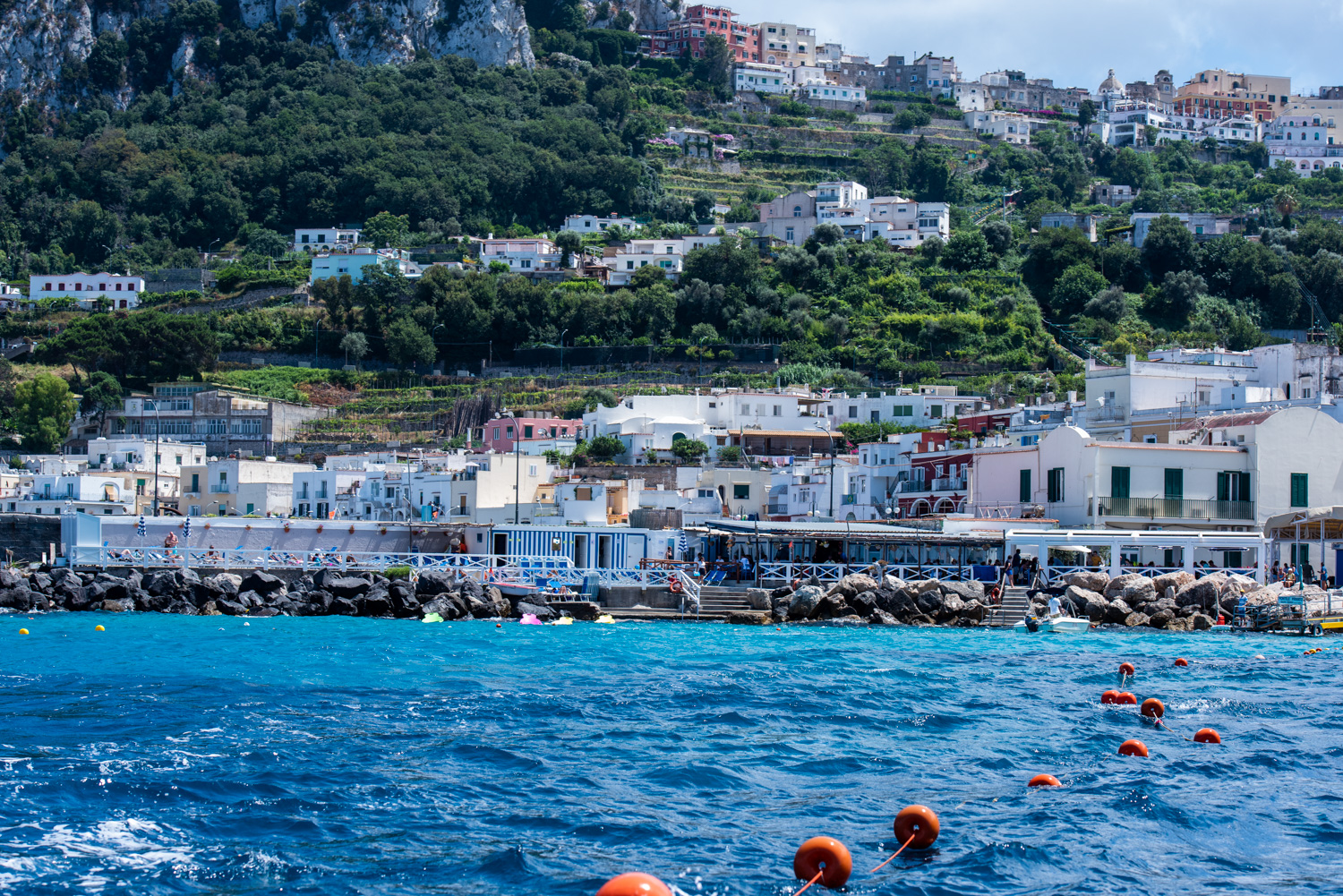 View from the water while departing the Marina Grande port in Capri, Italy.